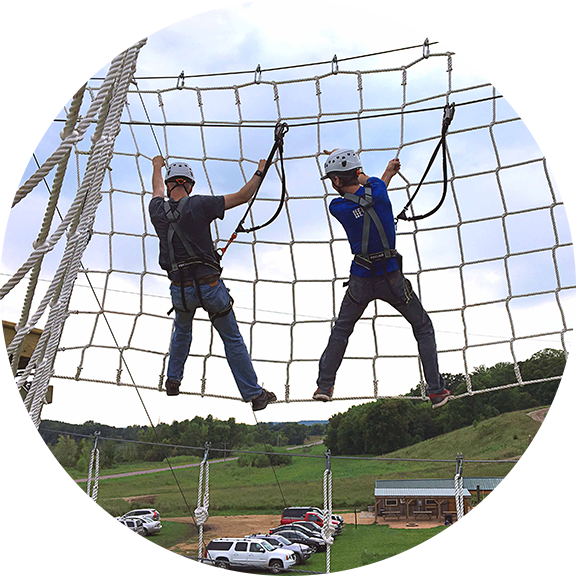 Two boys play on the adventure park 50 feet above the ground