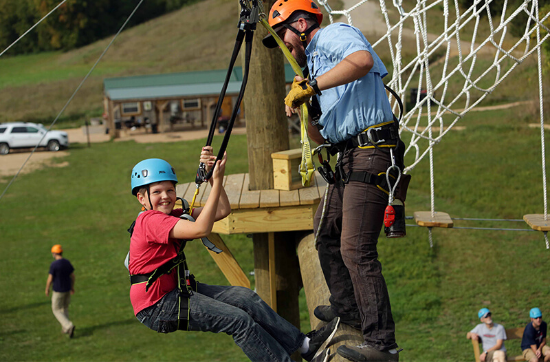 Man and boy on adventure park course