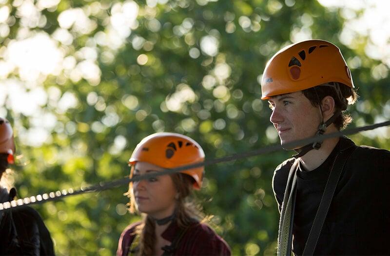 zipliners prepare to go on their zipline adventure